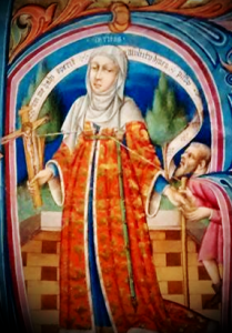The figure of Charity.  Depicted as a richly dressed woman, holds a crucifix in her right hand and gives a geggar with her left.  The fine lines that link Christs's side wound, with Charities heart and the beggars staff represents the Cross and Christs death that was the ultimate act of charity on behalf of mankind.  The scroll above the head proclaims.  Whoever has Charity covers a multitude of sins.